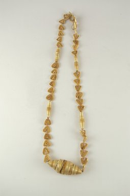 Tuareg. <em>Necklace</em>, 1981. Wax, straw, Length: 26 1/2 in. (67.3 cm). Brooklyn Museum, Gift of William C. Siegmann, 2000.39.1. Creative Commons-BY (Photo: Brooklyn Museum, CUR.2000.39.1_PS5.jpg)