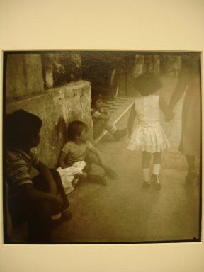Jonathan Bailey (American, born 1954). <em>Merida, Yucatan (Boys Watching Girl)</em>, 1983. Gold toned gelatin silver photograph, image: 5 1/2 x 5 1/2 in. (14 x 14 cm). Brooklyn Museum, Gift of the artist, 2000.65.2. © artist or artist's estate (Photo: Brooklyn Museum, CUR.2000.65.2.jpg)