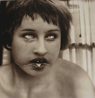 Simen Johan (Norwegian,  born 1973). <em>[Untitled] (Girl with Necklace)</em>, 1999. Toned gelatin silver photograph, Image: 19 1/4 x 19 in. (48.9 x 48.3 cm). Brooklyn Museum, Gift of the artist, 2000.66. © artist or artist's estate (Photo: Photograph courtesy of the artist, CUR.2000.66.jpg)