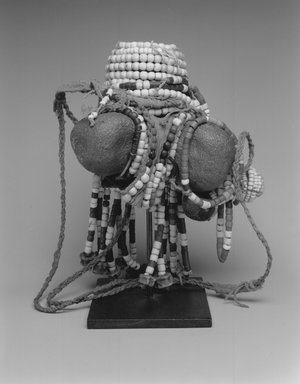 Turkana. <em>Doll</em>, early 20th century. Seed pods, glass beads, vegetable fibre, leather, 7 3/4 x 4 3/4 x 4 1/4 in.  (19.7 x 12.1 x 10.8 cm). Brooklyn Museum, Gift of Drs. Israel and Michaela Samuelly, 2000.72.5. Creative Commons-BY (Photo: Brooklyn Museum, CUR.2000.72.5_print_bw.jpg)