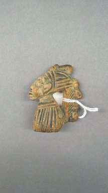 Yorùbá. <em>Wrist Pendant (Ogo Elegba)</em>, late 19th or early 20th century. Wood, pigment, 2 3/8 x 3/4 x 1 5/8in. (6 x 1.9 x 4.1cm). Brooklyn Museum, Gift of Drs. James J. Strain and Gladys Witt Strain, 2001.122.7. Creative Commons-BY (Photo: Brooklyn Museum, CUR.2001.122.7.jpg)