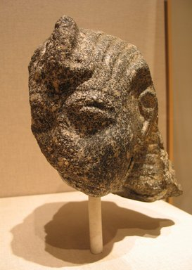 <em>Fragmentary Head of A King, probably Ramesses II</em>, ca. 1279-1213 B.C.E. Gray granite, 7 11/16 x 6 7/8 x 9 1/16 in.  (19.5 x 17.5 x 23.0 cm). Brooklyn Museum, Partial gift of James Lamb in honor of Paul O'Rourke and Charles Edwin Wilbour Fund, 2001.56. Creative Commons-BY (Photo: Brooklyn Museum, CUR.2001.56_wwg8.jpg)