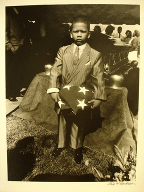 LeRoy W. Henderson, Jr.. <em>[Untitled] (Boy with Flag at Funeral)</em>, 1989. Gelatin silver photograph, 11 x 14 in.  (27.9 x 35.6 cm). Brooklyn Museum, Gift of Georgia O'Keeffe and Gift of Wallace B. Putnam from the Estate of Consuelo Kanaga, by exchange, 2001.62.1. © artist or artist's estate (Photo: Brooklyn Museum, CUR.2001.62.1.jpg)