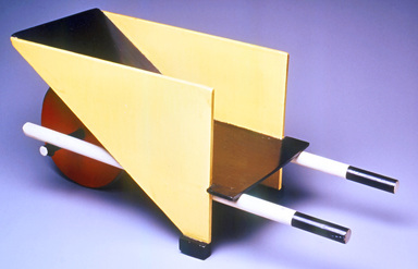 Gerrit Th. Rietveld (Dutch, 1888-1964). <em>Child's Wheelbarrow</em>, designed 1923; made 1958. Wood. pigment, metal, 13 × 27 1/2 × 11 in. (33 × 69.9 × 27.9 cm). Brooklyn Museum, Marie Bernice Bitzer Fund, 2001.87. Creative Commons-BY (Photo: Brooklyn Museum, CUR.2001.87_threequarter_back.jpg)