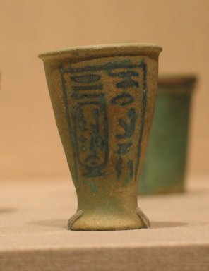 <em>Miniature Vessel with the Titulary of King Nectanebo II</em>, ca. 360-342 B.C.E. Faience, 2 1/16in. (5.3cm). Brooklyn Museum, Gift of Wunsch Foundation, Inc., 2001.95.1. Creative Commons-BY (Photo: Brooklyn Museum, CUR.2001.95.1_wwg8.jpg)