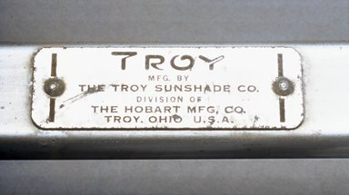 Troy Sunshade Company (division of Hobart Manufacturing Company). <em>Folding Lounge Chair</em>, ca.1952. Aluminum, plastic, nylon webbing, 34 3/4 x 24 5/8 x 61 7/8 in. (88.3 x 62.5 x 157.2cm). Brooklyn Museum, Gift of Barbara Jakobson, 2002.15. Creative Commons-BY (Photo: Brooklyn Museum, CUR.2002.15_mark.jpg)