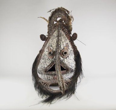 <em>Mask</em>, 20th century. Cane, feathers, clay, 24 1/2 x 17 x 24 in. (62.2 x 43.2 x 61 cm). Brooklyn Museum, Gift of the Mortimer F. Shapiro Trust, 2003.49.3. Creative Commons-BY (Photo: Brooklyn Museum, CUR.2003.49.3_front_PS5.jpg)