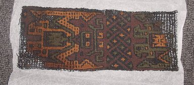 Paracas. <em>Textile Fragment</em>, ca. 300 B.C.E. Camelid (alpaca?) fiber, 3 1/2 x 9 3/4 in. (8.9 x 24.8 cm). Brooklyn Museum, Gift of Eric Jacobsen, 2003.81.1 (Photo: Brooklyn Museum, CUR.2003.81.1.jpg)