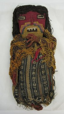 Chancay. <em>Funerary Doll</em>, ca. 1100-1350. Cotton and dyed camelid (alpaca?) fiber and reeds, 4 x 9 1/2 in. (10.2 x 24.1 cm). Brooklyn Museum, Gift of Eric Jacobsen, 2003.81.3. Creative Commons-BY (Photo: Brooklyn Museum, CUR.2003.81.3.jpg)