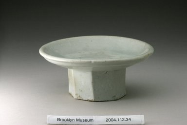 <em>Mounted Dish</em>, 19th century. Porcelain with white glaze, Height: 2 3/4 in. (7 cm). Brooklyn Museum, Gift of Dr. Alvin E. Friedman-Kien, 2004.112.34. Creative Commons-BY (Photo: Brooklyn Museum (in collaboration with National Research Institute of Cultural Heritage, , CUR.2004.112.34_view1_Heon-Kang_photo_NRICH.jpg)
