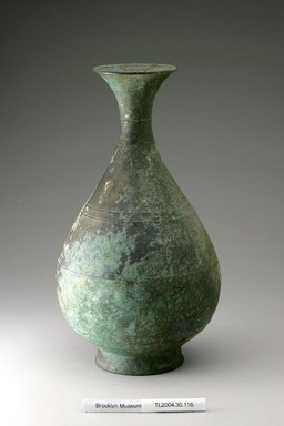 <em>Bottle</em>, 13th century. Bronze, Height: 12 1/16 in. (30.7 cm). Brooklyn Museum, The Peggy N. and Roger G. Gerry Collection, 2004.28.134. Creative Commons-BY (Photo: Brooklyn Museum (in collaboration with National Research Institute of Cultural Heritage, , CUR.2004.28.134_view1_Heon-Kang_photo_NRICH.jpg)