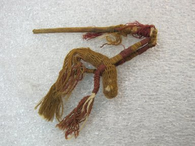 Chimú. <em>Knitted Bird Pin</em>, 1100-1450. Cotton, camelid fiber, wood, 2 3/8 × 2 1/4 in. (6 × 5.7 cm). Brooklyn Museum, Gift of Victor P. Nunez, 2004.53.39. Creative Commons-BY (Photo: , CUR.2004.53.39_view01.jpg)