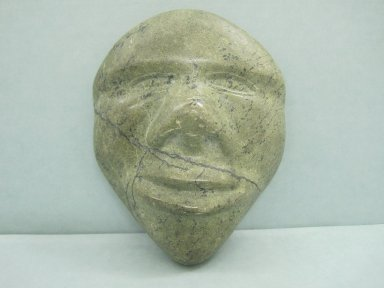 Inuit. <em>Miniature Head in Relief</em>, 1950-1980. Greenstone, 6 x 4 1/2 x 1 3/4 in. (15.2 x 11.4 x 4.4 cm). Brooklyn Museum, Hilda and Al Schein Collection, 2004.79.18. Creative Commons-BY (Photo: Brooklyn Museum, CUR.2004.79.18.jpg)