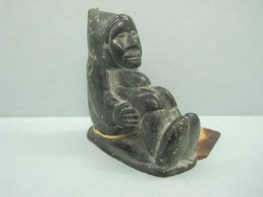 Uqitattu Juanisi Aqpaliea (1901-1983). <em>Seated Figure</em>, 1950-1980. Soapstone, 3 x 1 1/4 x 2 1/2 in. (7.6 x 3.2 x 6.4 cm). Brooklyn Museum, Hilda and Al Schein Collection, 2004.79.20. Creative Commons-BY (Photo: Brooklyn Museum, CUR.2004.79.20.jpg)