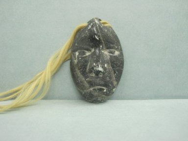 Inuit. <em>Amulet in the Form of a Head</em>, 1950-1980. Soapstone, 1 5/8 x 1 1/8 x 3/8 in. (4.1 x 2.9 x 1 cm). Brooklyn Museum, Hilda and Al Schein Collection, 2004.79.31. Creative Commons-BY (Photo: Brooklyn Museum, CUR.2004.79.31.jpg)