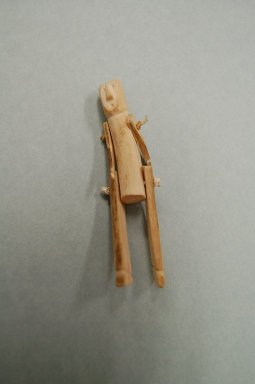 Inuit. <em>Figure with Movable Arms and Legs</em>, 1950-1980. Bone, cord, 4 3/8 x 7/8 x 3/4 in. (11.1 x 2.2 x 1.9 cm). Brooklyn Museum, Hilda and Al Schein Collection, 2004.79.49. Creative Commons-BY (Photo: Brooklyn Museum, CUR.2004.79.49.jpg)
