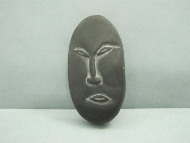 Inuit. <em>Amulet in the Form of a Head</em>, 1950-1980. Soapstone, 2 3/8 x 1 1/8 x 1/4 in. (6 x 2.9 x 0.6 cm). Brooklyn Museum, Hilda and Al Schein Collection, 2004.79.66. Creative Commons-BY (Photo: Brooklyn Museum, CUR.2004.79.66.jpg)