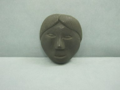Inuit. <em>Amulet in the Form of a Head</em>, 1950-1980. Soapstone, 1 5/8 x 1 3/8 x 5/8 in. (4.1 x 3.5 x 1.6 cm). Brooklyn Museum, Hilda and Al Schein Collection, 2004.79.71. Creative Commons-BY (Photo: Brooklyn Museum, CUR.2004.79.71.jpg)