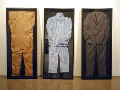 Rashid Johnson (American, born 1977). <em>The Evolution of the Negro Political Costume</em>, 2004. Mixed media, Each: 74 x 32 x 4 in. (188 x 81.3 x 10.2 cm). Brooklyn Museum, Gift of Lawrence Calcagno, Mrs. John Colt, Mr. and Mrs. Allan D. Emil, Dr. and Mrs. Milton H. Schlesinger, and Mr. and Mrs. Harry L. Tepper, by exchange, 2005.58a-c. © artist or artist's estate (Photo: The Renaissance Society, University of Chicago,, CUR.2005.58a-c_Renaissance_Society_photo_2004.jpg)