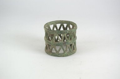 <em>Bracelet</em>. Copper alloy, 2 3/8 x 2 3/4 in. (6 x 7 cm). Brooklyn Museum, Gift of Dr. Werner Muensterberger and Michael Ward, 2006.66.22. Creative Commons-BY (Photo: Brooklyn Museum, CUR.2006.66.22_PS5.jpg)