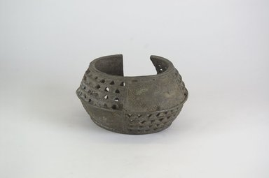 <em>Bracelet</em>. Copper alloy, 3 1/8 x 5 7/8 in. (8 x 15 cm). Brooklyn Museum, Gift of Dr. Werner Muensterberger and Michael Ward, 2006.66.31. Creative Commons-BY (Photo: Brooklyn Museum, CUR.2006.66.31_PS5.jpg)