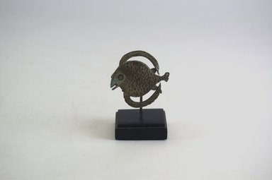 Akan. <em>Gold-weight (abrammuo): fish</em>, 19th century. Copper alloy, 1 15/16 x 1 15/16 x 1/16 in. (5 x 5 x 0.1 cm). Brooklyn Museum, Gift of Michael Ward, 2006.67.28. Creative Commons-BY (Photo: Brooklyn Museum, CUR.2006.67.28_PS5.jpg)