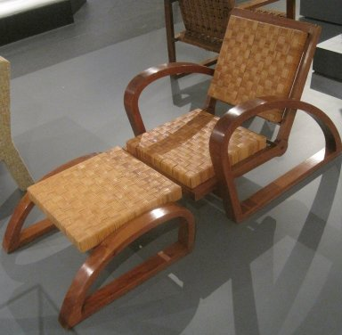 Francois Jourdain (French, 1876-1958). <em>Armchair</em>, ca. 1928. Mahogany, plant fiber, 30 x 37 x 27 1/2 in. (76.2 x 94 x 69.9 cm). Brooklyn Museum, Gift of Frederick A. McConkey, 2006.80.1. Creative Commons-BY (Photo: Brooklyn Museum, CUR.2006.80.1_view2.jpg)