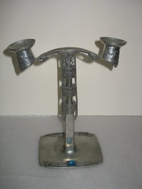 Archibald Knox (English, 1864-1933). <em>Candlestick, One of Pair</em>, Registered 1905. Pewter, enamel, 11 x 9 1/2 x 5 in. (27.9 x 24.1 x 12.7 cm). Brooklyn Museum, Gift of the Estate of Dr. Eleanor Z. Wallace, 2007.41.7a-c. Creative Commons-BY (Photo: Brooklyn Museum, CUR.2007.41.7a-c.jpg)