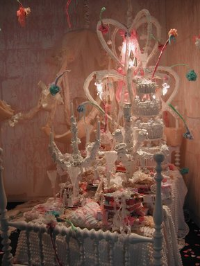 Vadis Turner (American, born 1977). <em>Reception</em>, 2009. Twin size bed frame, twin mattress and twin box spring, wooden headboard and footboard, chenille fabric and bedspread, bibles, tampons, undergarments, garter belts, panty hose, found jewelry, beads, chocolate coins, artist embroidered gloves, artist made pillows, wax paper, birth control pills, plastic figurines, cotton linens, porcelain plates, light bulbs, ribbons, and other mixed media.