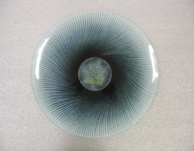 Maurice Heaton (American, born Switzerland 1900-1990). <em>Plate</em>, ca. 1965. Glass, height: 5/8 in. (1.6 cm); diameter: 13 3/4 in. (34.9 cm). Brooklyn Museum, Gift of Janice Gottesman in honor of Joan Nissman and Morton Abromson, 2009.50. Creative Commons-BY (Photo: Brooklyn Museum, CUR.2009.50.jpg)