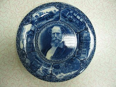 The Rowland & Marsellus Company (1893-1938). <em>Charles Dickens Plate</em>, Registered 1904, Made: early 20th century. Glazed earthenware, 1 1/8 x 11 in. (2.9 x 27.9 cm). Brooklyn Museum, Gift of Pat Nichols in honor of Joanne Leshen, 2009.77.1. Creative Commons-BY (Photo: Brooklyn Museum, CUR.2009.77.1.jpg)