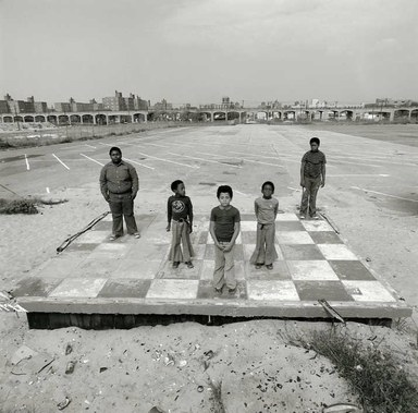 Arthur Tress (American, born 1940). <em>Boys on Checker Floor, Far Rockaway, NY</em>, 1980. Gelatin silver photograph, 11 x 14 in. (27.9 x 35.6 cm). Brooklyn Museum, Gift of William and Marilyn Braunstein, 2009.86.8. © artist or artist's estate (Photo: Brooklyn Museum, CUR.2009.86.8.jpg)