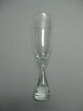 Bent Severin (Danish, 1925-2012). <em>Champagne Flute, Princess Pattern</em>, designed 1957, manufactured 1958-1984. Glass, height: 8 1/2 in. (21.6 cm); diameter: 2 5/16 in. (5.9 cm). Brooklyn Museum, Gift of The American College in memory of Charles J. Zimmerman, CLU®, 2010.14.3. Creative Commons-BY (Photo: Brooklyn Museum, CUR.2010.14.3.jpg)
