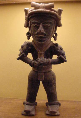 Veracruz. <em>Standing Warrior Figure</em>, ca. 200-500 C.E. Ceramic, pigment from plant saps, resins, crushed plants, asphalt, and black soot, 21 1/2 x 9 1/2 x 5 3/4 in. (54.6 x 24.1 x 14.6 cm). Brooklyn Museum, Gift of the Coltrera Collection, 2010.23.3. Creative Commons-BY (Photo: Brooklyn Museum, CUR.2010.23.3.jpg)