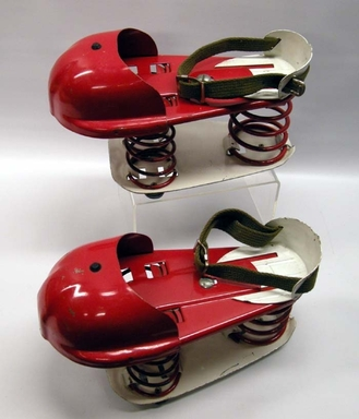 """George Pierce (American, active mid-20th century). <em>Pair of """"Satellite"""" Jumping Shoes</em>, Patented June 18, 1968. Metal, textile, rubber, 5 3/4 x 4 5/8 x 10 in. (14.6 x 11.7 x 25.4 cm). Brooklyn Museum, Gift of Harry Greenberger, 2010.51a-b. Creative Commons-BY (Photo: Brooklyn Museum, CUR.2010.51a-b.jpg)"""