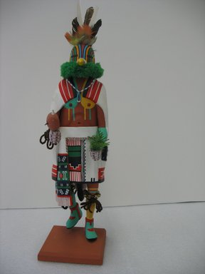 Henry Shelton (born 1929). <em>Kachina Doll</em>, 1960-1970. Cottonwood root, acrylic pigment, yarn, feathers, metal bells, beads, plastic, 20 1/2 x 5 1/2 x 6 1/2 in. (52.1 x 14 x 16.5 cm). Brooklyn Museum, Gift of Edith and Hershel Samuels, 2010.6.4. Creative Commons-BY (Photo: Brooklyn Museum, CUR.2010.6.4.jpg)