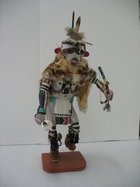 Henry Shelton (born 1929). <em>Wildcat (Tokotsi) Kachina Doll</em>, 1960-1970. Cottonwood root, fur, acrylic pigment, hide, feathers, wood, metal, turquoise, 21 3/8 x 10 3/4 x 12 in. (54.3 x 27.3 x 30.5 cm). Brooklyn Museum, Gift of Edith and Hershel Samuels, 2010.6.5. Creative Commons-BY (Photo: Brooklyn Museum, CUR.2010.6.5.jpg)