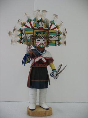 Henry Shelton (born 1929). <em>Kachina Doll</em>, 1960-1970. Cottonwood root, acrylic pigment, feathers, yarn, beads, 19 x 10 x 5 1/2 in. (48.3 x 25.4 x 14 cm). Brooklyn Museum, Gift of Edith and Hershel Samuels, 2010.6.6. Creative Commons-BY (Photo: Brooklyn Museum, CUR.2010.6.6.jpg)
