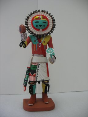 Henry Shelton (born 1929). <em>Kachina Doll</em>, 1960-1970. Cottonwood root, acrylic pigment, silver discs, yarn, silk ribbon, fur, beads, 20 1/2 x 7 x 8 in. (52.1 x 17.8 x 20.3 cm). Brooklyn Museum, Gift of Edith and Hershel Samuels, 2010.6.8. Creative Commons-BY (Photo: Brooklyn Museum, CUR.2010.6.8.jpg)