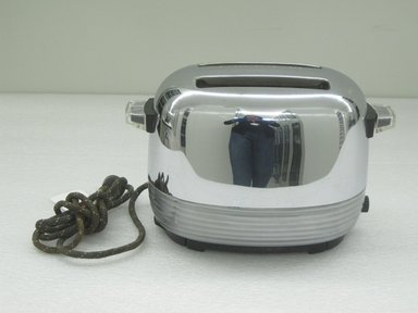"""Donald Earl Daily (American, 1914-1997). <em>""""Automatic Pop-Up """" Toaster, Model 1481</em>, ca. 1947 (designed), 1948 (patent). Chromed metal, plastic, electrical elements., 7 x 11 x 6 in. (17.8 x 27.9 x 15.2 cm). Brooklyn Museum, Gift of David A. Hanks in honor of George R. Kravis II, 2010.75.2. Creative Commons-BY (Photo: Brooklyn Museum, CUR.2010.75.2.jpg)"""