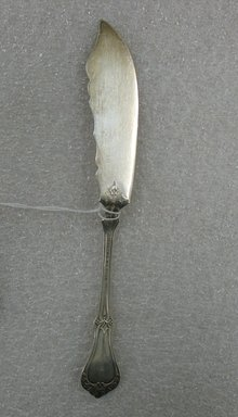 William Wise and Son. <em>Butter Knife</em>, 19th century. Silver, 7 1/4 x 1 x 3/4 in. (18.4 x 2.5 x 1.9 cm). Brooklyn Museum, Gift of William Lee Younger in memory of Joseph A. Henehan, 2010.77.7. Creative Commons-BY (Photo: Brooklyn Museum, CUR.2010.77.7_back.jpg)