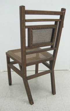 George Jacob Hunzinger (American, born Germany, 1835-1898). <em>Side Chair</em>, Patented March 13, 1883. Wood, cane, straw braid., 35 3/8 x 17 1/2 x 20 3/8 in. (89.9 x 44.5 x 51.8 cm). Brooklyn Museum, Designated Purchase Fund, 2011.13. Creative Commons-BY (Photo: Brooklyn Museum, CUR.2011.13_back.jpg)