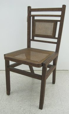 George Jacob Hunzinger (American, born Germany, 1835-1898). <em>Side Chair</em>, Patented March 13, 1883. Wood, cane, straw braid., 35 3/8 x 17 1/2 x 20 3/8 in. (89.9 x 44.5 x 51.8 cm). Brooklyn Museum, Designated Purchase Fund, 2011.13. Creative Commons-BY (Photo: Brooklyn Museum, CUR.2011.13_front.jpg)