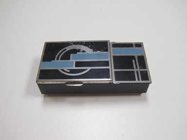 <em>Cigarette Box</em>, ca. 1930. White metal, pigment, wood, glass, 1 1/2 x 5 3/8 x 2 7/8 in. (3.8 x 13.7 x 7.3 cm). Brooklyn Museum, Gift of Arnold Lehman, 2011.15.2. Creative Commons-BY (Photo: Brooklyn Museum, CUR.2011.15.2_exterior.jpg)