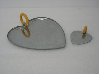 """Chase Brass & Copper Co., Inc. (founded 1876-present). <em>""""Valentine Serving Set"""" Scoop, Model No. 90094</em>, ca. 1935. Chromed metal, plastic, 1 3/8 x 3 15/16 x 5 1/8 in. (3.5 x 10.0 x 13.0 cm). Brooklyn Museum, Gift of Arnold Lehman, 2011.15.6. Creative Commons-BY (Photo: Brooklyn Museum, CUR.2011.15.6.jpg)"""