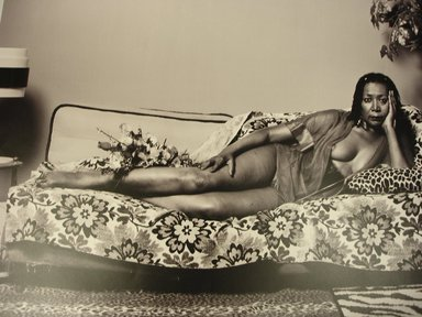 Mickalene Thomas (American, born 1971). <em>Madame Mama Bush in Black and White</em>, 2007; printed 2011. Chromogenic photograph, Sheet: 18 3/4 x 23 1/2 in. (47.6 x 59.7 cm). Brooklyn Museum, Gift of Mickalene Thomas, 2011.26. © artist or artist's estate (Photo: Brooklyn Museum, CUR.2011.26.jpg)