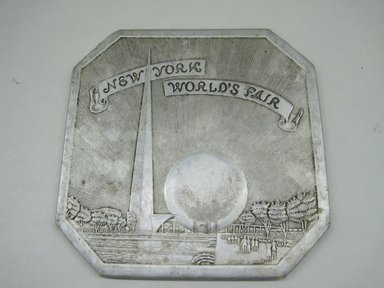 "Sayford Company. <em>Hot Plate, ""New York World's Fair,""</em> ca. 1939. Metallic paper, other paper, 1/4 x 6 x 6 in. (0.6 x 15.2 x 15.2 cm). Brooklyn Museum, Gift of Linda S. Ferber, 2011.43.2. Creative Commons-BY (Photo: Brooklyn Museum, CUR.2011.43.2.jpg)"