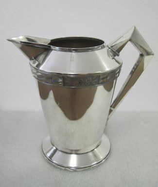 "Albert F. Saunders (1878-1964). <em>Pitcher, ""Modernistic"" Line</em>, 1928. Silverplate, 8 1/4 x 9 x 8 in. (21 x 22.9 x 20.3 cm). Brooklyn Museum, Gift of Ravi R. Mathura in memory of Milo, 2011.82. Creative Commons-BY (Photo: Brooklyn Museum, CUR.2011.82.jpg)"