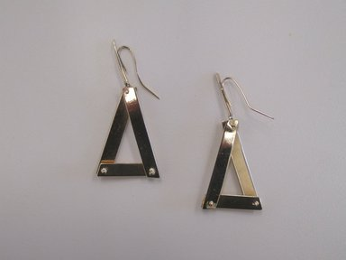 Art Smith (American, born Cuba, 1917-1982). <em>Pair of Earrings</em>, 1975. Gold, 2 x 15/16 x 7/8 in. (5.1 x 2.4 x 2.2 cm). Brooklyn Museum, Gift of Linda Kandel Kuehl in loving memory of her husband, John R. Kuehl, 2011.89.1a-b. Creative Commons-BY (Photo: Brooklyn Museum, CUR.2011.89.1a-b.jpg)