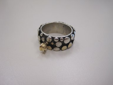 Art Smith (American, born Cuba, 1917-1982). <em>Man's Wedding Ring</em>, 1974. Gold and Sterling Silver., 3/8 x 1 in. (1 x 2.5 cm). Brooklyn Museum, Gift of Linda Kandel Kuehl in loving memory of her husband, John R. Kuehl, 2011.89.3. Creative Commons-BY (Photo: Brooklyn Museum, CUR.2011.89.3.jpg)